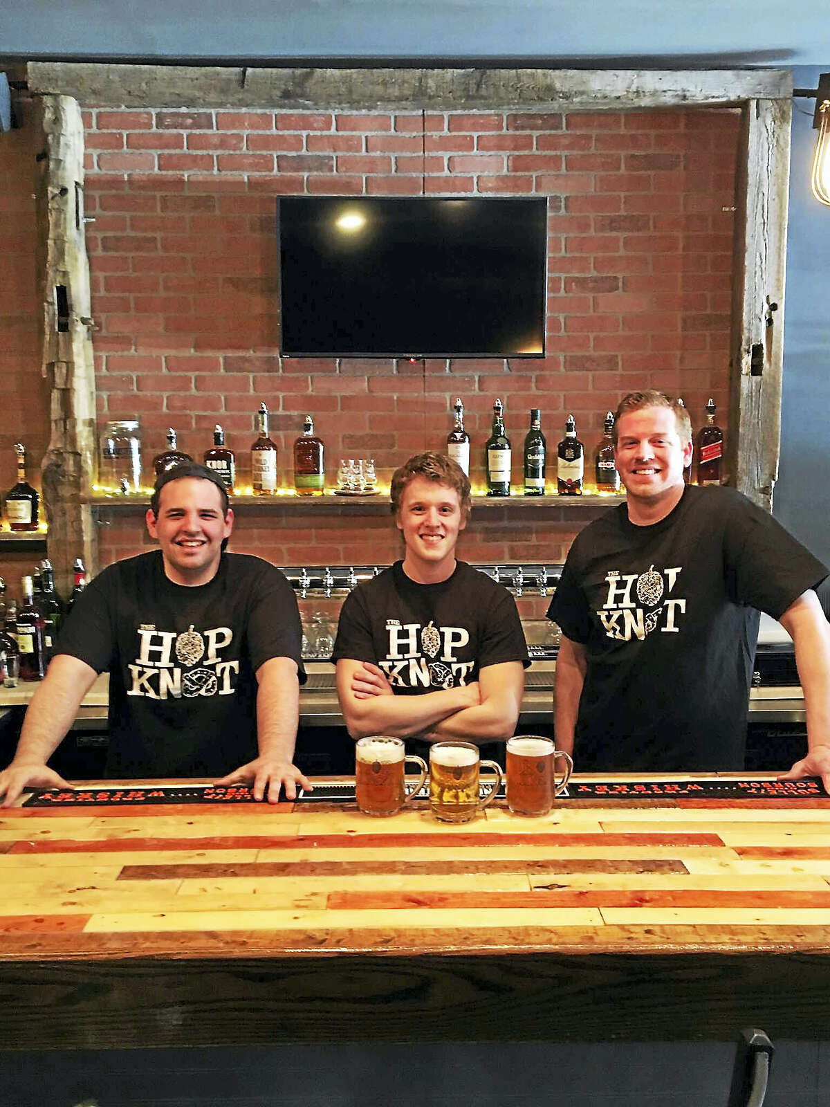 University of Connecticut graduates are launching the Hop Knot beer and pretzel bar on Friday in Middletown. From left are general manager Anthony Calamusa and owners John Schauster and Michael Boney.