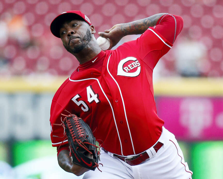 FILE - In this Sept. 7, 2015, file photo, Cincinnati Reds relief pitcher Aroldis Chapman throws in the ninth inning of a baseball game against the Pittsburgh Pirates in Cincinnati. Chapman and the New York Yankees have agreed to a one-year contract worth $11,325,000, avoiding salary arbitration. (AP Photo/John Minchillo, File) Photo: AP / AP