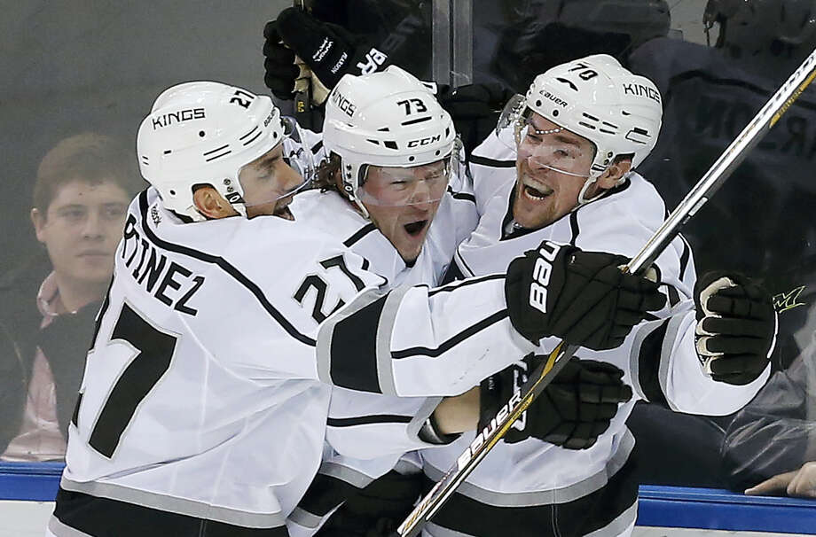 Los Angeles Kings left wing Tanner Pearson (70) celebrates with center Tyler Toffoli (73) and defenseman Alec Martinez (27) after scoring against the New York Rangers in overtime Friday in New York. The Kings won 5-4. Photo: The Associated Press  / AP
