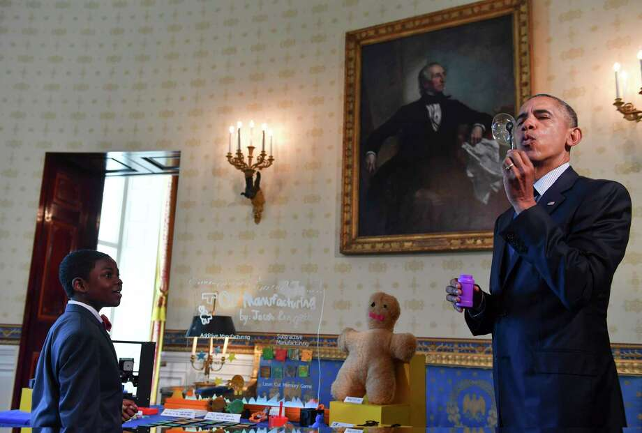 Jacob Leggette, 9, of Baltimore looks in amazement as President Barack Obama blows a bubble while visiting his science exhibit during the annual White House Science Fair in April 2016. Obama started the fair as a way to highlight and encourage STEM education. Photo: Ricky Carioti/Washington Post  / The Washington Post