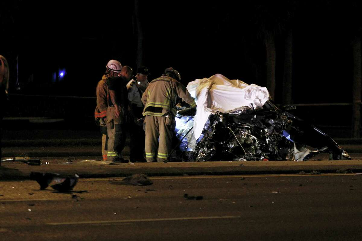 Law enforcement investigate a crash late Wednesday, Oct. 26, 2016 in Tampa, Fla. The crash occurred when a vehicle lost control, crossed a median and slammed head on into a minivan.