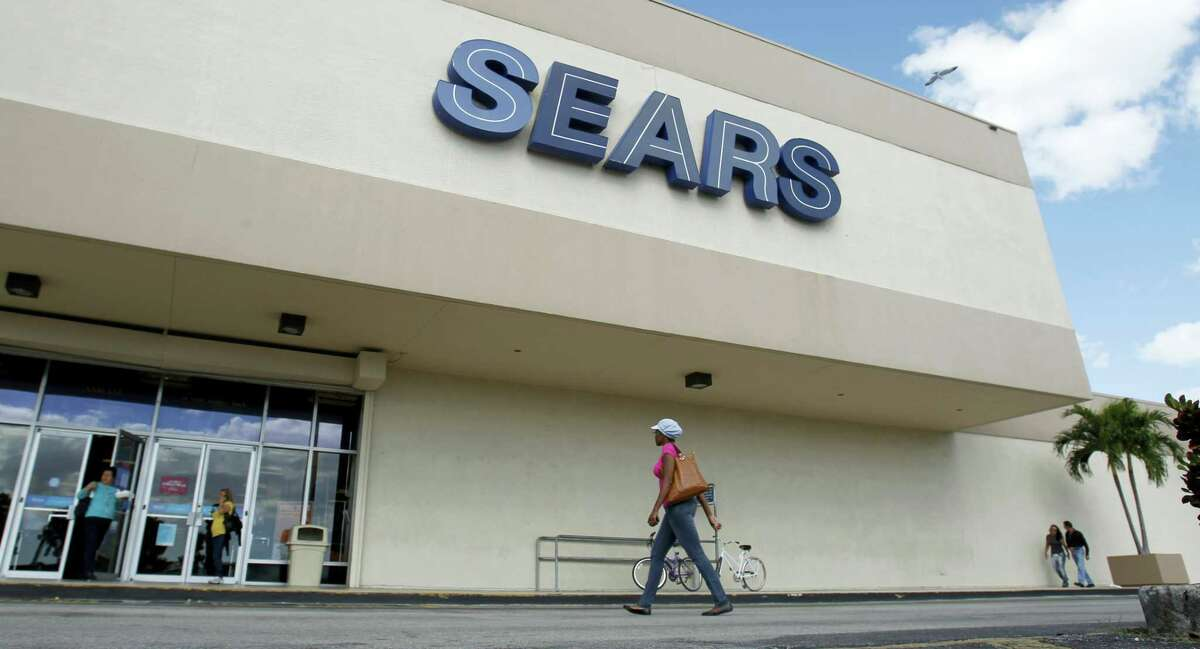 In this Nov. 9, 2012, photo, a Sears store is shown in Hialeah, Fla. Sears Holdings Corp. is announcing Thursday that it will close 68 Kmart stores and 10 Sears stores as it struggles to restore profitability.