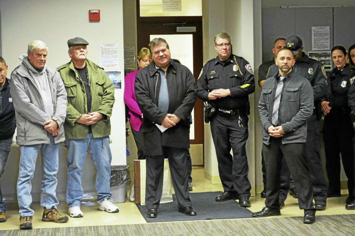 Middletown Police Officer Luigi Liistro retired from the department Friday after 39 years of service in a surprise send-off party in the community room.