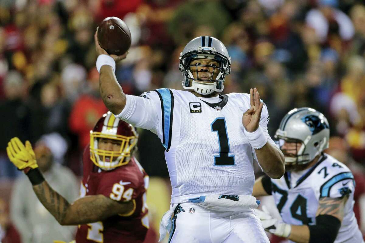 Carolina Panthers quarterback Cam Newton passes the ball during the first half against the Washington Redskins. The Panthers won 26-15.