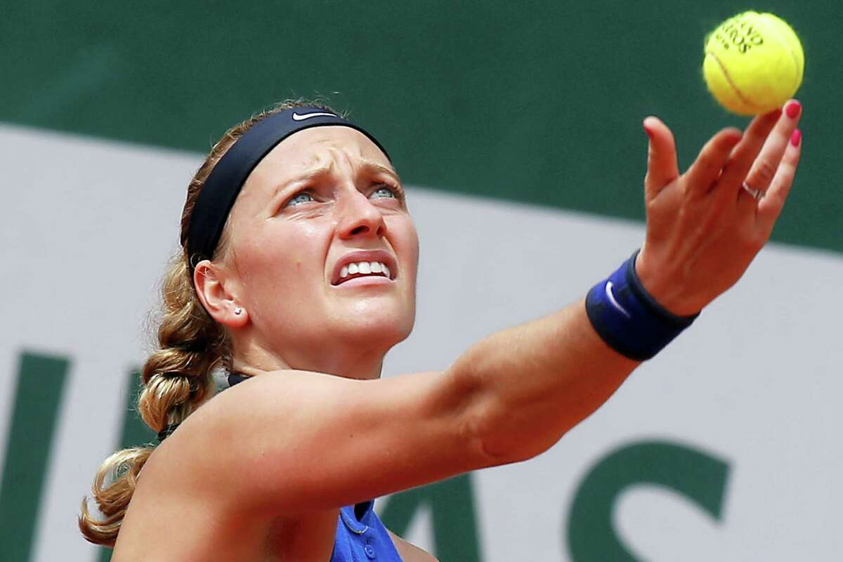 In this May 27, 2016 photo, Petra Kvitova of the Czech Republic serves in her third round match of the French Open tennis tournament against Shelby Rogers of the U.S. at the Roland Garros stadium in Paris. Two-time Wimbledon champion Petra Kvitova has been injured during an attack in her flat in the Czech Republic. Kvitova's spokesman Karel Tejkal says Tuesday Dec. 20, 2016 Kvitova suffered a left hand injury and has been treated by doctors.