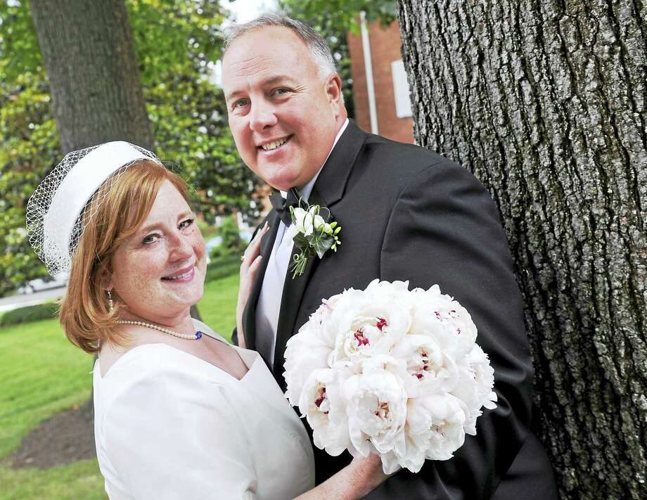 Denise Pavone-Brooks and Jeffrey Stork on their wedding day in Arlington, Virginia, in 2010. Photo: Mark Gail — The Washington Post  / The Washington Post