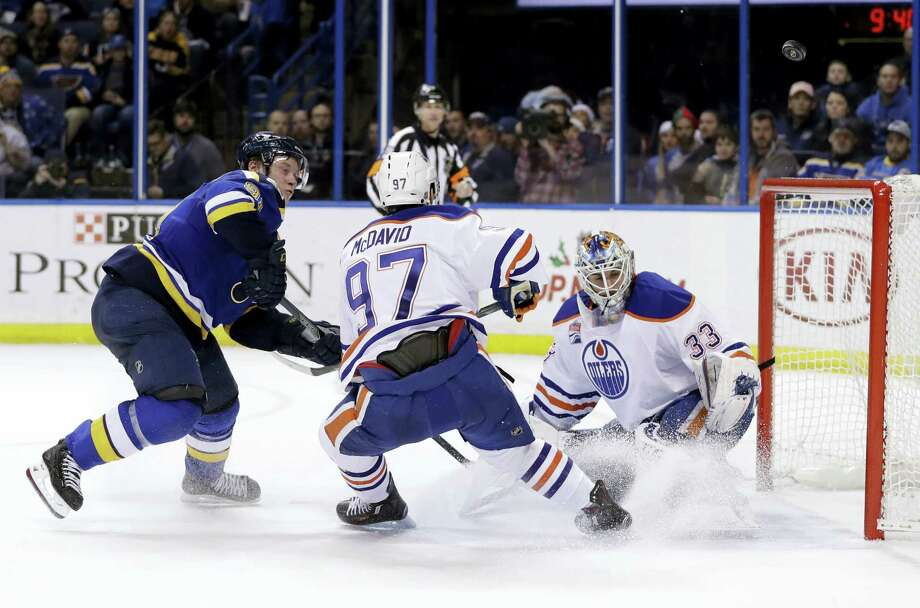 St. Louis Blues right wing Vladimir Tarasenko, of Russia, watches as a puck sails wide past Edmonton Oilers' Connor McDavid (97) and goalie Cam Talbot (33) during overtime of an NHL hockey game Monday, Dec. 19, 2016 in St. Louis. The Oilers won 3-2 in overtime. Photo: AP Photo/Jeff Roberson  / Copyright 2016 The Associated Press. All rights reserved.
