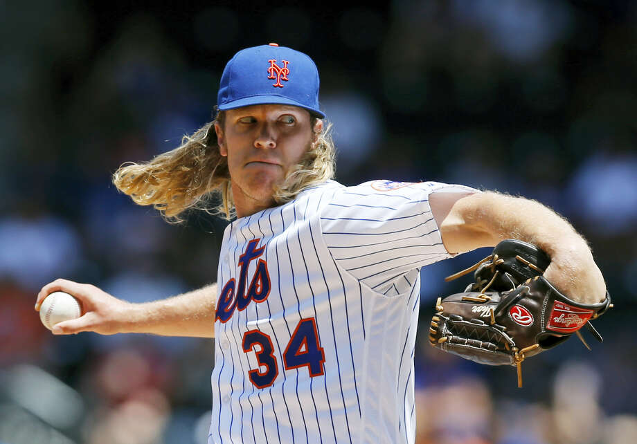 New York Mets starting pitcher Noah Syndergaard (34) winds up in the first inning Wednesday. Photo: Kathy Willens — The Associated Press  / AP