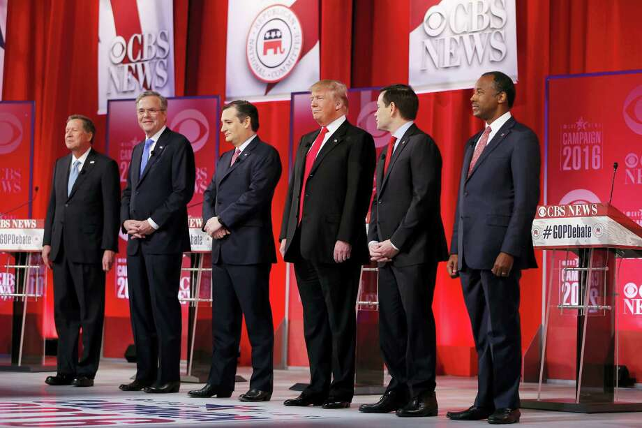Republican presidential candidates, from left, Ohio Gov. John Kasich, former Florida Gov. Jeb Bush, Sen. Ted Cruz, R-Texas, businessman Donald Trump, Sen. Marco Rubio, R-Fla., retired neurosurgeon Ben Carson take the stage before the CBS News Republican presidential debate at the Peace Center, Saturday, Feb. 13, 2016, in Greenville, S.C. Photo: AP Photo/John Bazemore / AP