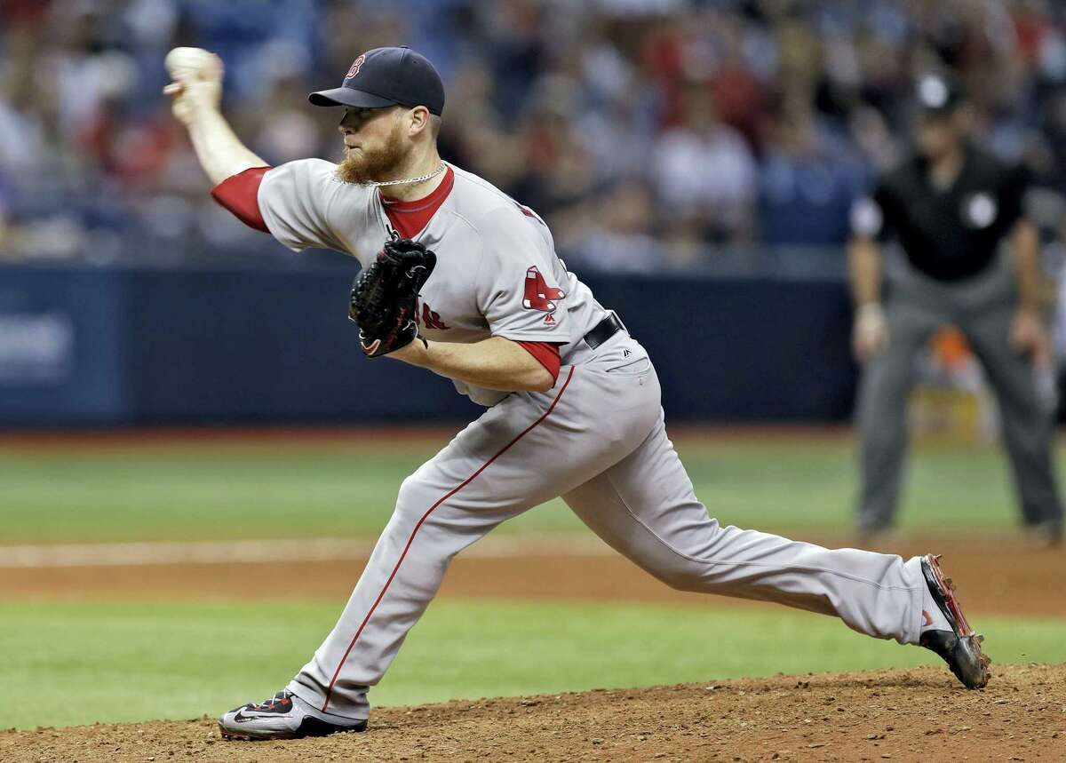 Boston relief pitcher Craig Kimbrel delivers to the Tampa Bay Rays during the ninth inning Tuesday in St. Petersburg, Fla.