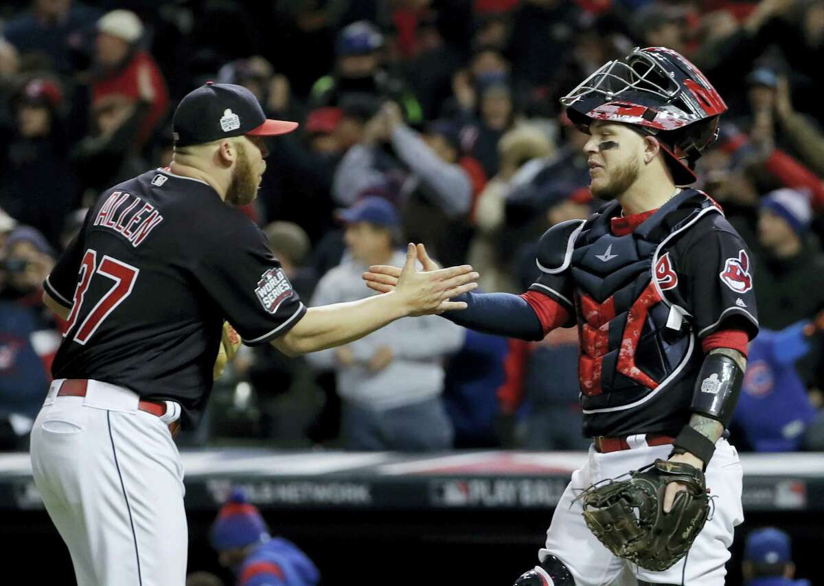 Cleveland Indians relief pitcher Cody Allen, left, and catcher Roberto Perez celebrate after their 6-0 win against the Chicago Cubs in Game 1 of the Major League Baseball World Series on Oct. 25, 2016 in Cleveland.