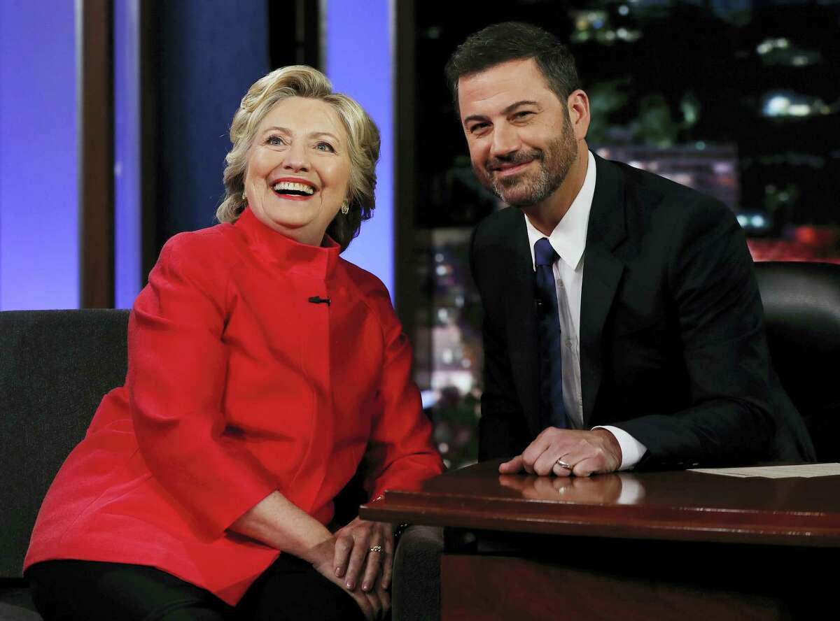 """Democratic presidential nominee Hillary Clinton pauses to pose for a photograph as she talks with Jimmy Kimmel during a break in taping of """"Jimmy Kimmel Live!"""" in Los Angeles on Aug. 22, 2016."""