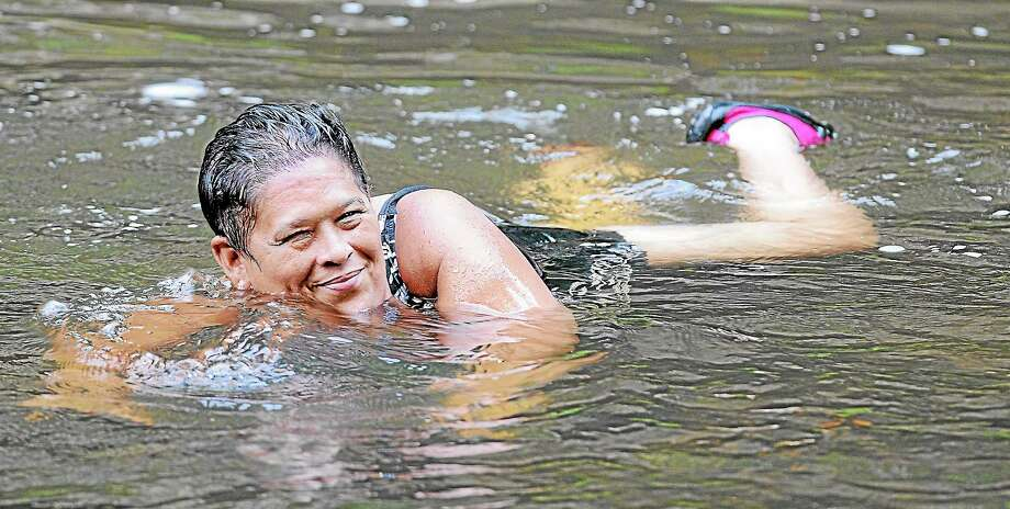 Meriden resident Lucy O'Farrill cools off at Wadsworth Falls State Park in Middlefield in this 2013 file photo. Photo: Middletown Press File Photo  / TheMiddletownPress