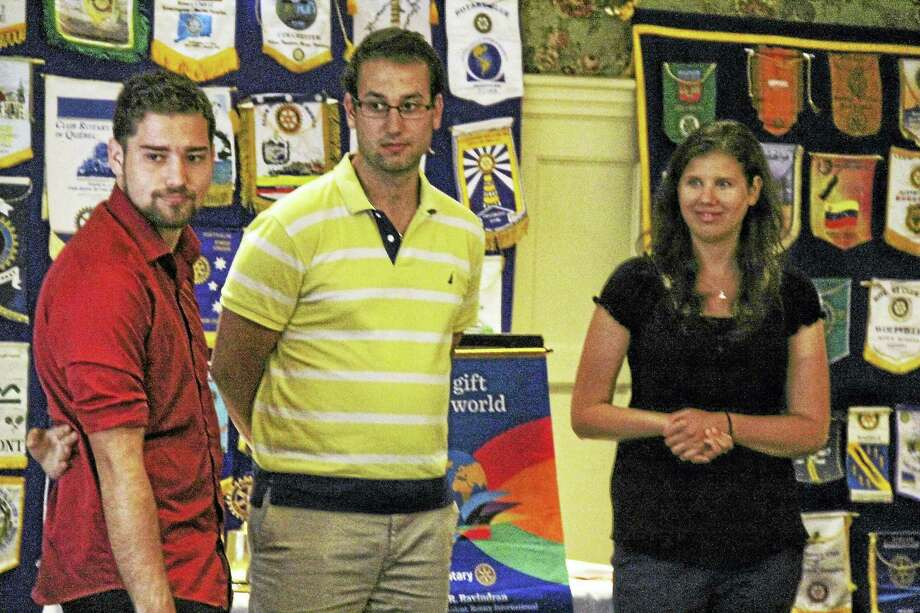 From left, Edo Shiloh, Sagi Zazon and Amit Horovitz speak to members of the Middletown Rotary about their experiences over the past year volunteering as Israeli youth emissaries. Photo: Kathleen Schassler — The Middletown Press   / Kathleen Schassler All Rights