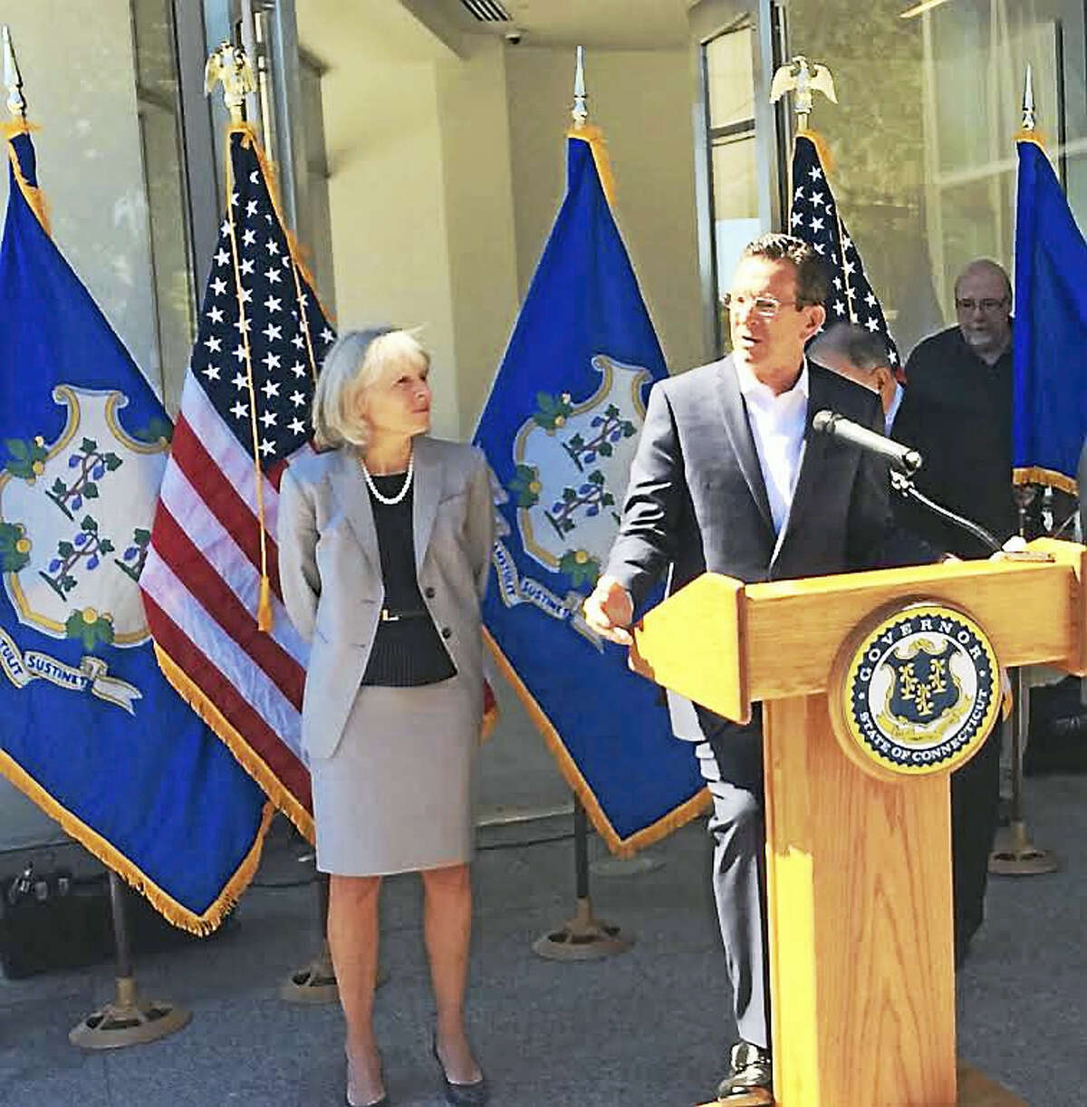 LUTHER TURMELLE — NEW HAVEN REGISTER Gov. Dannel P. Malloy and Department of Economic and Community Development Commissioner Catherine Smith discuss new data regarding the state's First Five program Tuesday at Alexion Pharmaceuticals in New Haven.