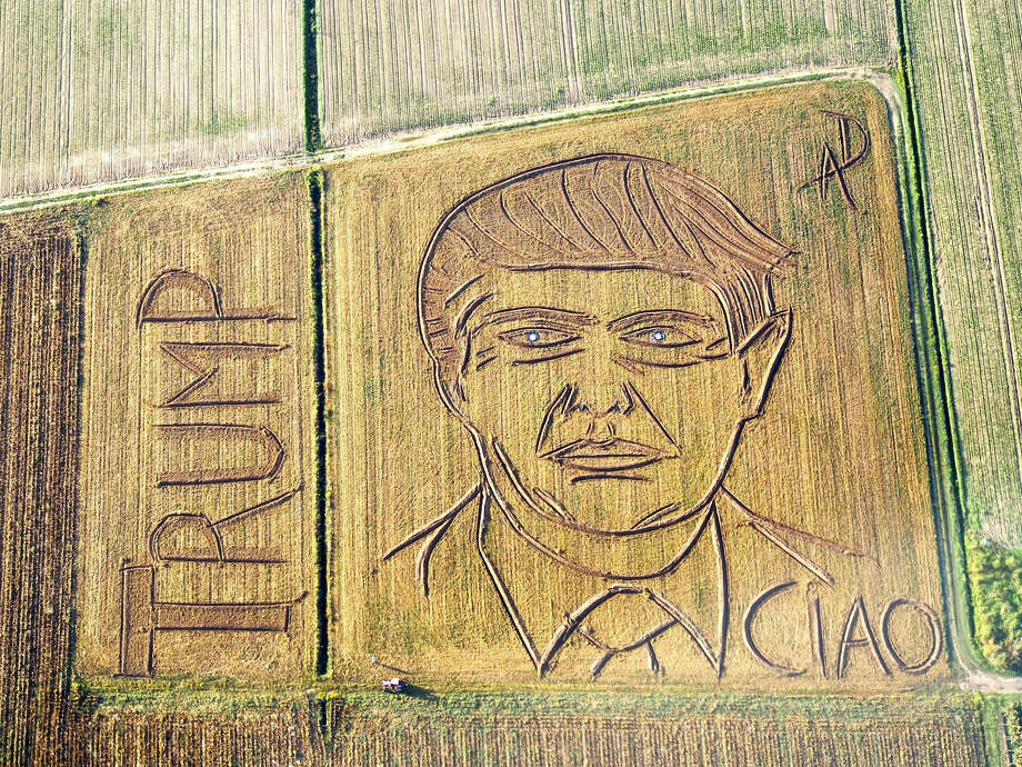 "In this photo taken on Tuesday, Oct. 25, 2016, an aerial view of a giant portrait of U.S. Republican Presidential nominee Donald Trump. Italian land artist Dario Gambarin has used his tractor to transform a field near the Italian city of Verona into a giant portrait of Donald Trump. This artist created a similar portrait for Democratic nominee Hillary Clinton in September. Gambarin created the portrait on a 25,000-square-meter field, writing ""Ciao"" beneath Trump's left shoulder, signifying recent polls that show Clinton leading the race. Photo: Dario Gambarin Via AP   / Dario Gambarin"