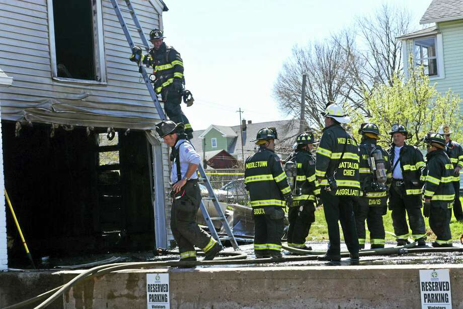 A blaze consumed a 440 square-foot garage at 19 Grand Street on Wednesday afternoon, where firefighters worked for more than an hour to knock it down and contain the hot spots. Photo: Cassandra Day — THE Middletown Press