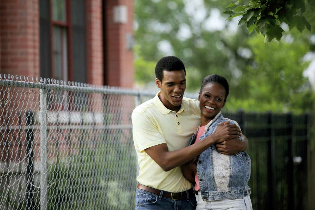 """This image released by Roadside Attractions shows Tika Sumpter, right, and Parker Sawyers in a scene from """"Southside With You."""""""