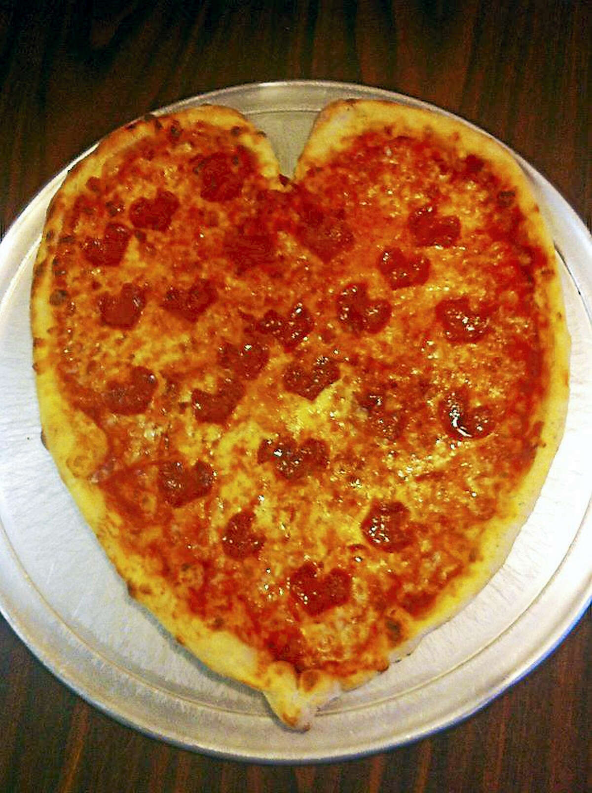 Heart-shaped pizzas and raviolis are on the menu this weekend at Jerry's Pizza and pancakes are for breakfast at Carmela's on the Extension.