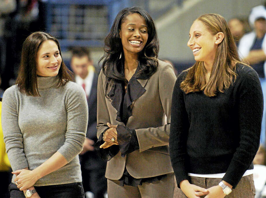 Former University of Connecticut women's basketball players Sue Bird, left, Swin Cash, center, and Diana Taurasi, seen here in 2006 sharing a light moment during the Huskies of Honor induction ceremony at Gampel Pavillion, were named three of the WNBA's Top 20 all-time players. Photo: File Photo - The Associated Press  / AP2006