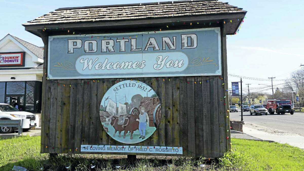 Portland's welcoming sign sits in front of Dunkin' Donuts on Main Street.