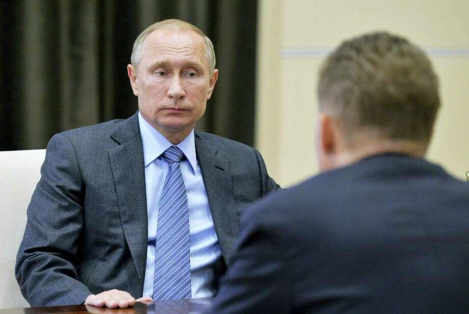 Russian President Vladimir Putin meets with Gazprom Head Alexei Miller in the Novo-Ogaryovo residence outside Moscow, Russia, Monday. Photo: Alexei Druzhinin — Sputnik, Kremlin Pool Photo Via AP  / POOL SPUTNIK KREMLIN