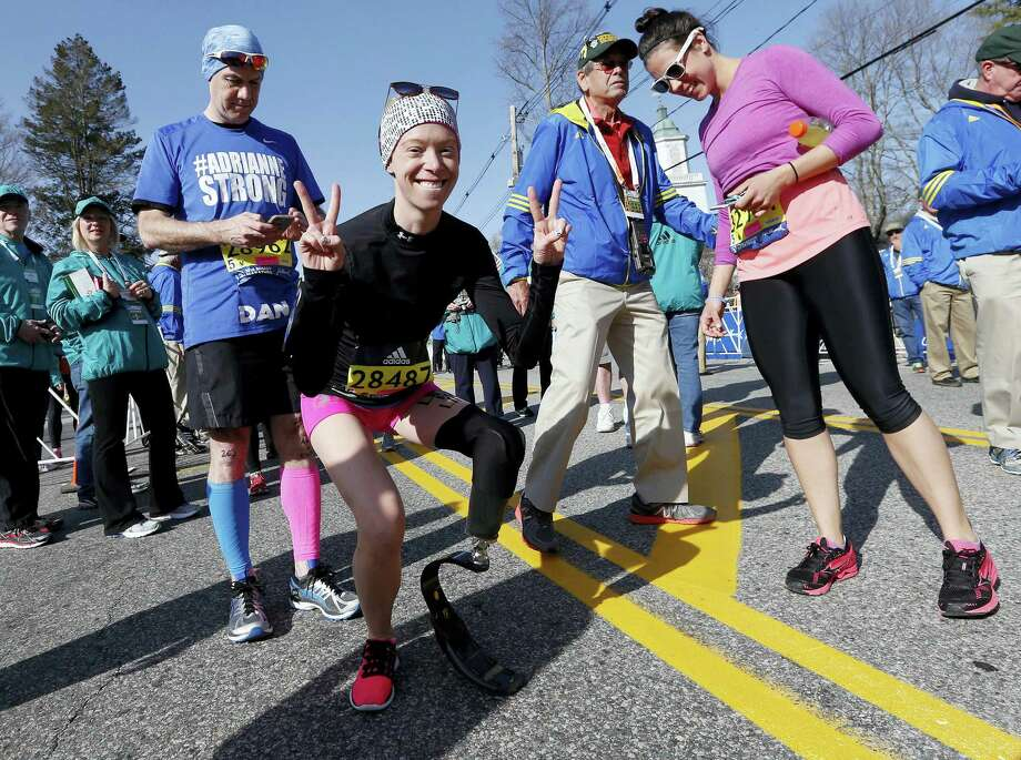 Boston Marathon bombing survivor Adrianne Haslet, center, poses Monday in Hopkinton, Mass., before running the race. Photo: Michael Dwyer — The Associated Press  / Copyright 2016 The Associated Press. All rights reserved. This material may not be published, broadcast, rewritten or redistributed without permission.