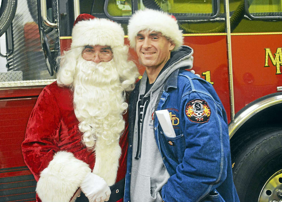 """Mr. Claus was played by Middletown Fire Marshal Al """"Santastefano,"""" left, who is accompanied by event coordinator, firefighter Dave Ribnicky."""