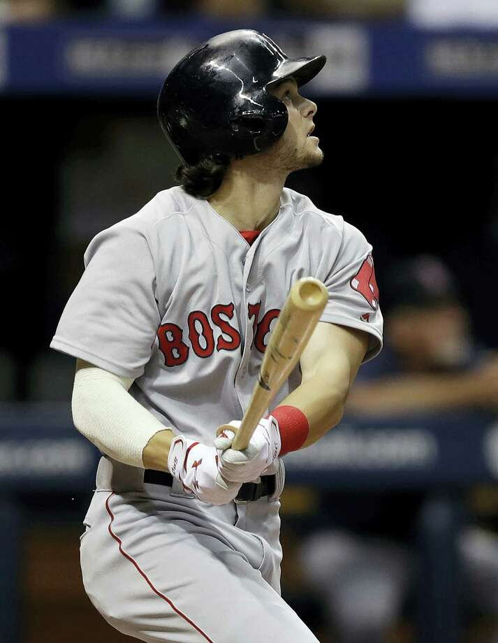 Andrew Benintendi hits a sacrifice fly in the fourth inning on Monday. Photo: Chris O'Meara — The Associated Press  / Copyright 2016 The Associated Press. All rights reserved. This material may not be published, broadcast, rewritten or redistribu