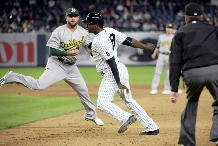 The Yankees' Didi Gregorius is tagged out by Athletics first baseman Yonder Alonso, left, after being caught in a rundown during the fifth inning on Tuesday. Photo: Bill Kostroun — The Associated Press  / FR51951 AP