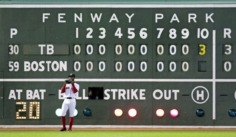 Red Sox left fielder Chris Young stands in front of the scoreboard pitch during the 10th inning on Tuesday. Photo: Charles Krupa — The Associated Press  / Copyright 2016 The Associated Press. All rights reserved. This material may not be published, broadcast, rewritten or redistributed without permission.