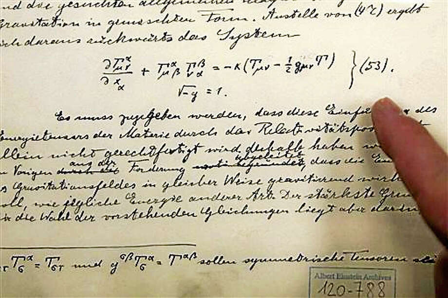 The original historical documents related to Albert Einstein's prediction of the existence of gravitational waves are seen at the Hebrew university in Jerusalem, Thursday, Feb. 11, 2016. In a blockbuster announcement, scientists said Thursday that after decades of trying they have detected gravitational waves, the ripples in the fabric of space-time that Einstein predicted a century ago. Photo: AP Photo/Sebastian Scheiner   / AP