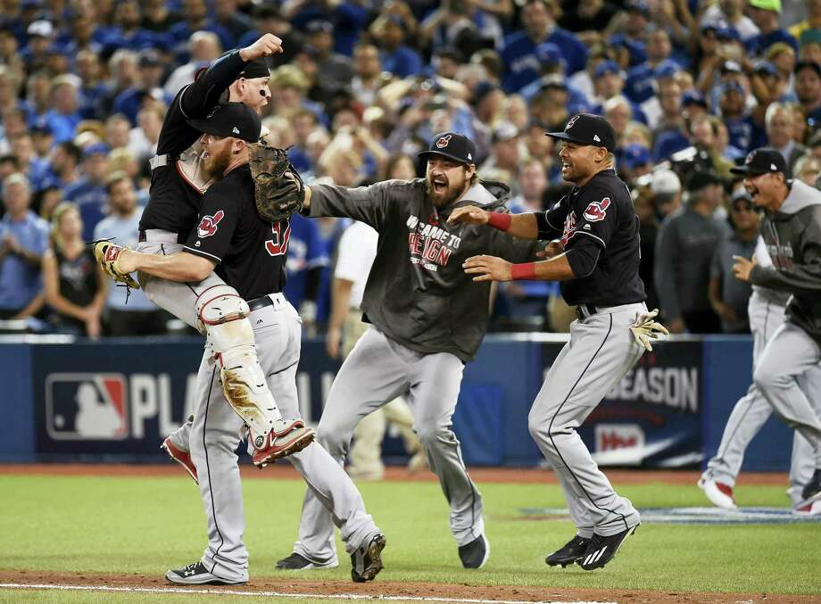 In this Oct. 19, 2016 photo, Cleveland Indians relief pitcher Cody Allen (37), cather Roberto Perez (55) and teammates Andrew Miller and Coco Crisp celebrate the team's 3-0 victory over the Toronto Blue Jays during Game 5 of the baseball American League Championship Series, in Toronto. Four months after LeBron James and the Cavaliers ended the city's championship drought at 52 years by winning the NBA title, the Indians are back in the World Series for the first time since 1997. Photo: Nathan Denette/The Canadian Press Via AP, File  / The Canadian Press