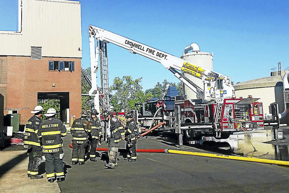 Firefighters from Cromwell and Middletown helped a fire at the Mattabassett District sewer treatment plant at 245 Main St. in Cromwell Monday morning. The cause was smoldering in the incineration system near the exhaust, officials said. Photo: Cassandra Day — The Middletown Press