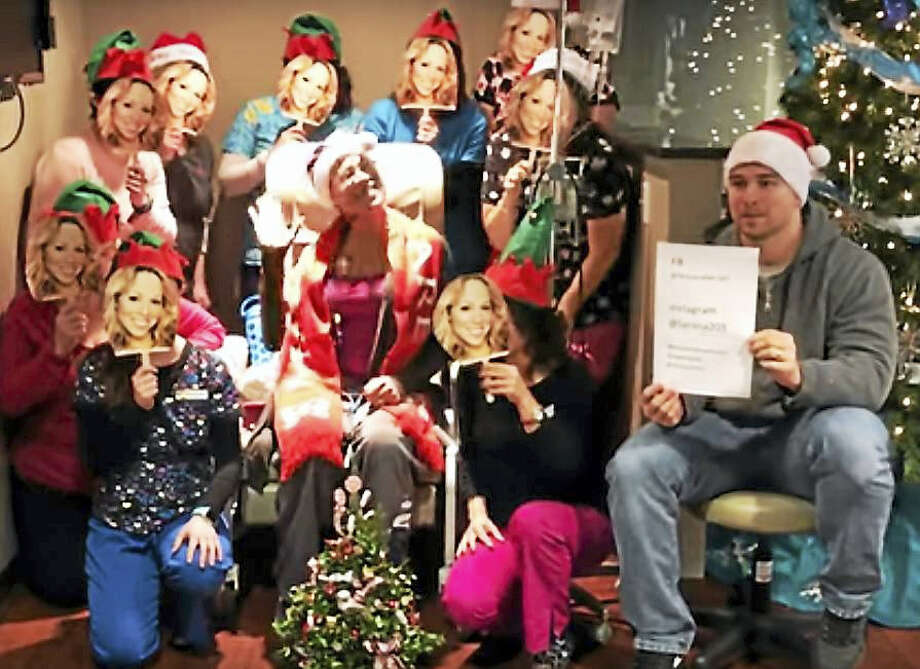 """Larissa Podermanski's oncology nurses donned Mariah Carey masks and sang backup to Podermanski's lead in their rendition of """"All I Want for Christmas is You,"""" which was posted online to Facebook, YouTube and Ellen Nation. Photo: Screenshot"""