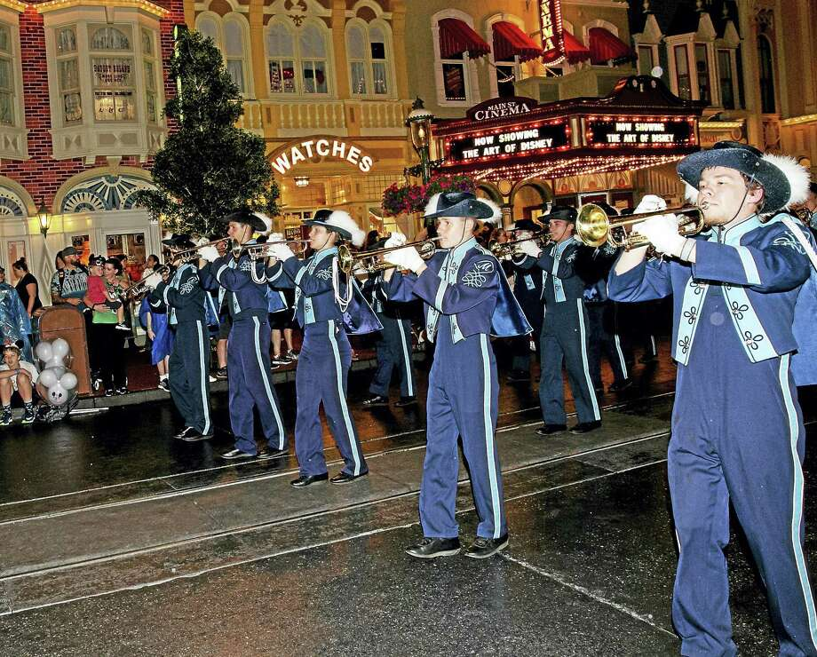 The trumpet section of the Middletown High Marching Band entertained a large audience at this year's Disney Magic Kingdom parade in Orlando, Florida. Photo: Sandy Aldieri — Special To The Press