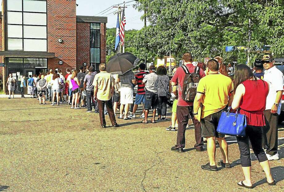 """The line was out the door and stretching around the parking lot last summer at the state Department of Motor Vehicles office on State Street in Hamden after a week-long shutdown for a computer upgrade. The agency said Tuesday its computers were experiencing """"intermittent outages."""" Photo: Wes Duplantier — New Haven Register/File"""