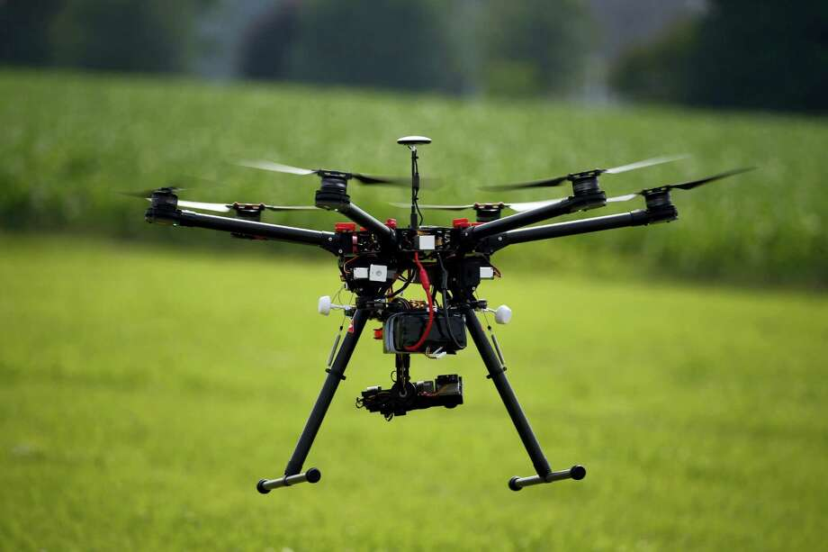 A hexacopter drone is flown during a drone demonstration at a farm and winery on potential use for board members of the National Corn GrowersJune 11, 2015 in Cordova, Md. Photo: AP Photo/Alex Brandon  / Copyright 2016 The Associated Press. All rights reserved. This material may not be published, broadcast, rewritten or redistribu