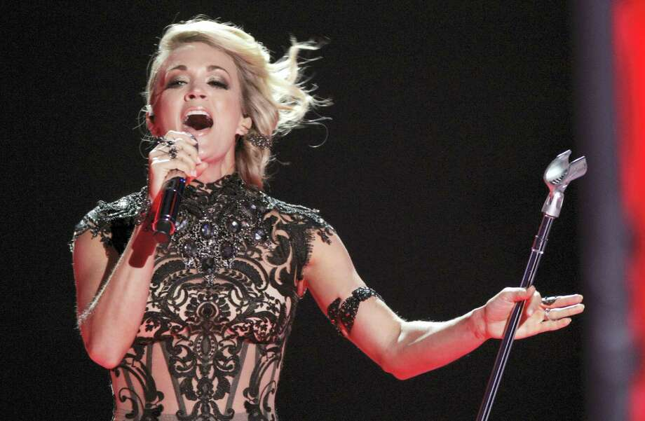 """In this June 8, 2016 photo, Carrie Underwood performs """"Church Bells"""" at the CMT Music Awards in Nashville, Tenn. Underwood will be singing a new theme song, """"Oh, Sunday Night,"""" during the first game telecast on Sept. 11 between the New England Patriots and the Arizona Cardinals. Photo: Photo By Wade Payne/Invision/AP, File  / Invision"""