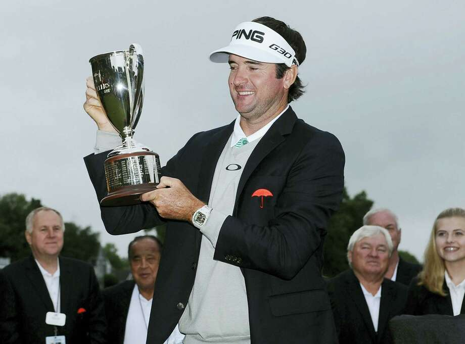 Bubba Watson holds the championship trophy after winning the Travelers Championship on June 28, 2015, in Cromwell. Watson beat out Paul Casey in a playoff. Photo: Jessica Hill - Associated Press File Photo  / FR125654 AP