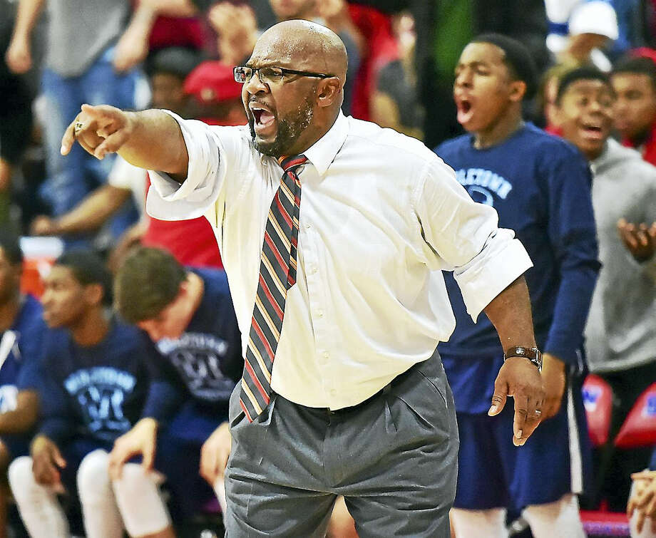 Middletown boys basketball coach Rick Privott shouts instructions during last year's state tourney. The Blue Dragons host No. 1 Hillhouse tonight. Photo: The Middletown Press File Photo  / New Haven RegisterThe Middletown Press