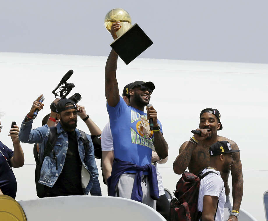 LeBron James holds up the Larry O'Brien Trophy after arriving in Cleveland on Monday. James came home with the trophy he promised, and the championship Cleveland has coveted for 52 years. Photo: Tony Dejak — The Associated Press  / Copyright 2016 The Associated Press. All rights reserved. This material may not be published, broadcast, rewritten or redistribu