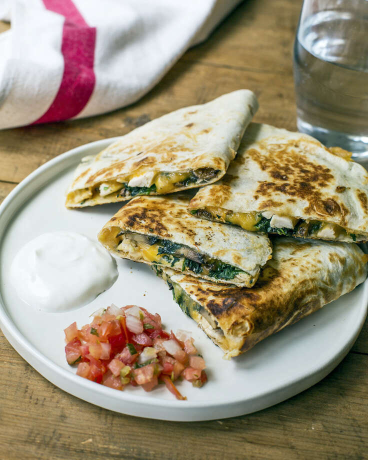 Spinach, mushroom and chicken quesadillas are a great idea for the pre-trick-or-treat rush. Photo: Sarah Crowder — The Associated Press  / Sarah E Crowder