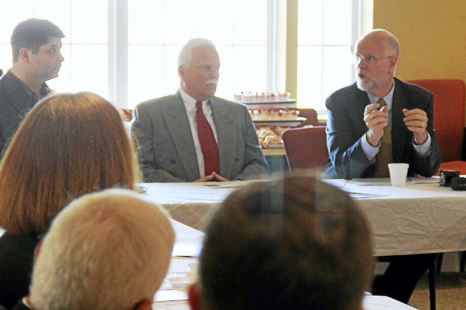From left, Middletown Mayor Dan Drew and Middlesex County Chamber of Commerce Small Business Development Center Counselor Paul Dodge listen as state Comptroller Kevin Lembo talks about the state's massive deficit Tuesday morning at the Village at South Farms. Photo: Kathleen Schassler — The Middletown Press  / Kathleen Schassler All Rights