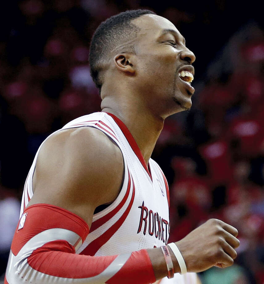 The Rockets' Dwight Howard reacts after missing a free throw. Photo: The Associated Press File Photo  / AP