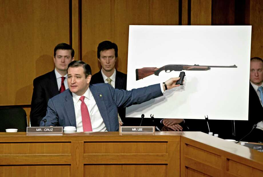 Senate Judiciary Committee member, then-freshman Sen. Ted Cruz, R-Texas uses a life size photo of a Remington 750, a popular hunting rifle, to make a point about the proposed ban on certain kinds of guns, during the Senate Judiciary Committee hearing Jan. 30, 2013 on what lawmakers should do to curb gun violence in the wake a shooting rampage at that killed 20 schoolchildren in Newtown, Conn. Photo: AP Photo/J. Scott Applewhite  / AP
