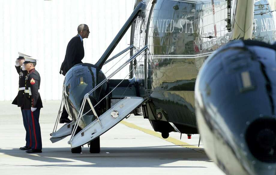 President Barack Obama boards Marine One at Santa Monica Municipal Landing Zone in Santa Monica, Calif., as he begins his travel back to Washington, Tuesday, Oct. 25, 2016. Obama is returning to Washington after spending a few days in Nevada and California campaigning for Democratic presidential candidate Hillary Clinton. Photo: AP Photo/Susan Walsh   / Copyright 2016 The Associated Press. All rights reserved.