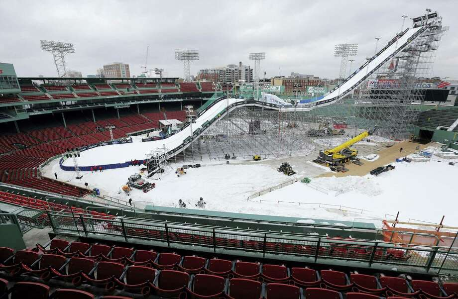 A ramp constructed for the Big Air at Fenway skiing and snowboarding U.S. Grand Prix tour event is covered in snow at Fenway Park on Wednesday. Photo: Steven Senne — The Associated Press  / AP