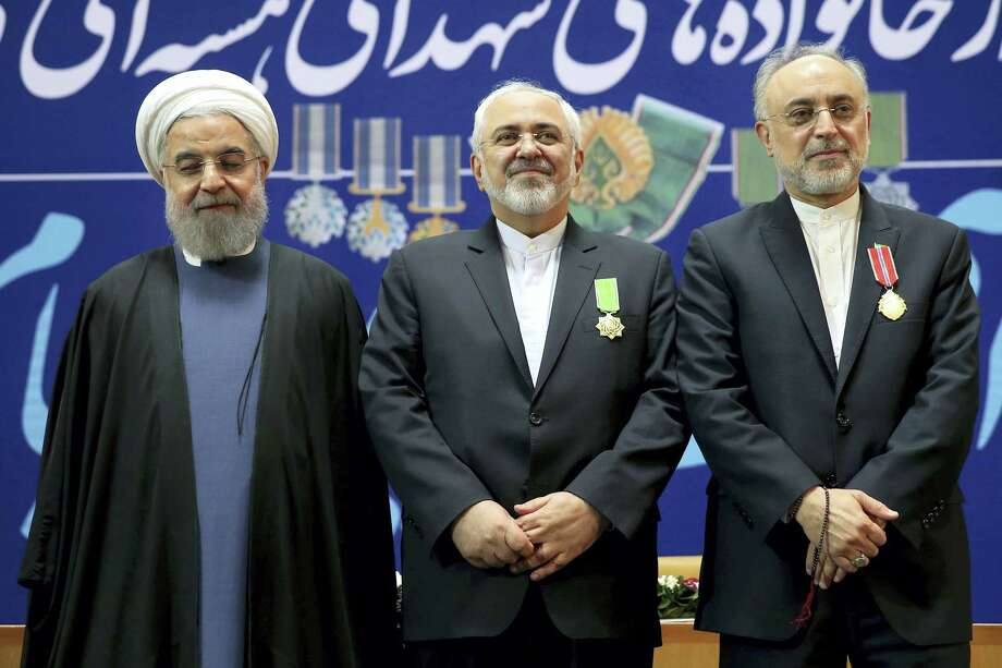 Iranian President Hassan Rouhani, left, Foreign Minister Mohammad Javad Zarif, centre, and Vice President and head of Iran's Atomic Energy Organization, Ali Akbar Salehi pose for a photograph after Zarif and Salehi were awarded medals of honor in a ceremony in Tehran, Iran, Monday, Feb. 8, 2016. Iran awarded medals of honor on Monday to its nuclear negotiators who helped clinch a landmark deal with world powers last year. Photo: AP Photo/Ebrahim Noroozi   / AP