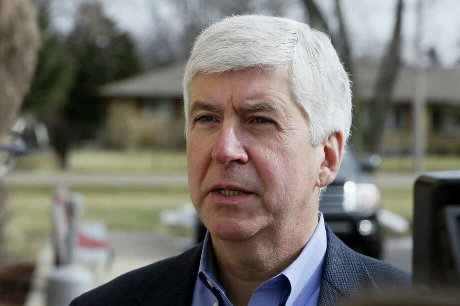 In this Friday, Feb. 5, 2016 photo, Michigan Gov. Rick Snyder is interviewed after visited a church that's distributing water and filters to its predominantly Latino parishioners in Flint, Mich. Snyder will propose spending $195 million more to address Flint's water crisis and another $165 million updating infrastructure across the state in response to lead contamination overwhelming the city. Photo: AP Photo/Carlos Osorio, File  / AP